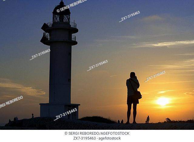 Sunset. Pretty woman backlight in Es Cap de Barbaria lighthouse, in Formentera, Balears Islands. Spain. Barbaria cape formentera lighthouse road