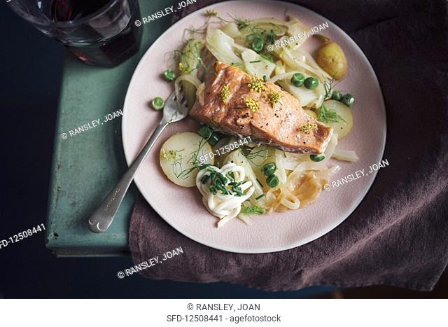 Wild alaskan salmon baked with shavings of fennel, fresh peas and potatoes