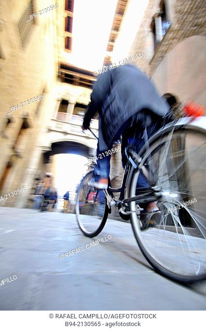 Bicycle. Bisbe street between Sant Jaume square and Nova square. Gothic area. Ciutat Vella district. Noegothic bridge, 1928