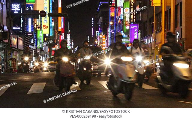 Cars and motorcycle crossing an intersection, Taipei, Taiwan, East Asia