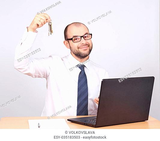 Man realtor offering keys. Isolated on white background