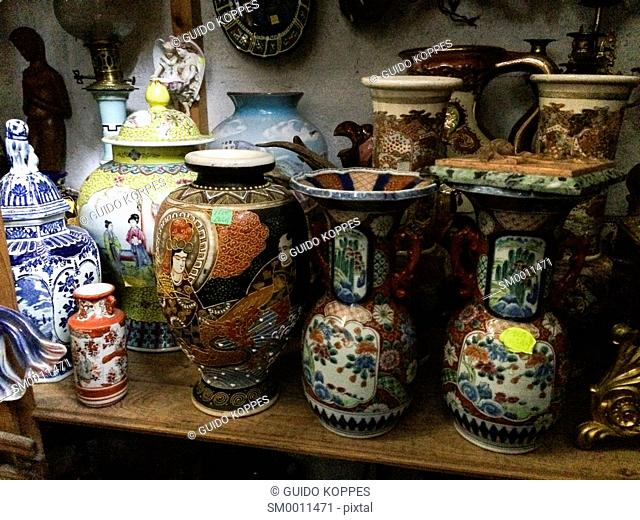 Tilburg, Netherlands. Collection of antique vases in a whole sale store for antiques