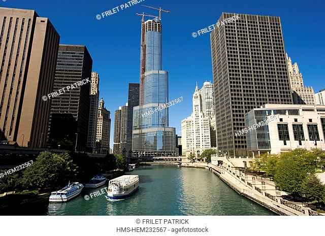 United States, Illinois, Chicago, the Chicago River and the Trump hotel under construction which will be 1,066 feet high by Skidmore