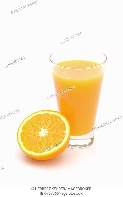 Glass of orange juice and orange half