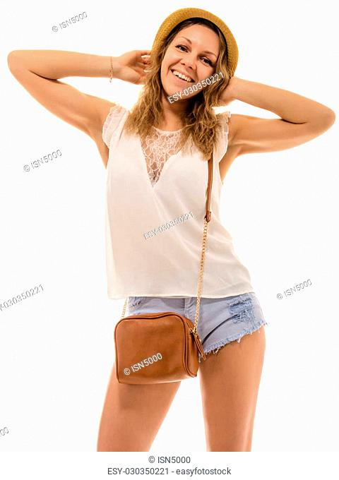 0dbdaf0bd47a Cheerful young attractive girl in a straw hat and denim shorts with a small bag  over