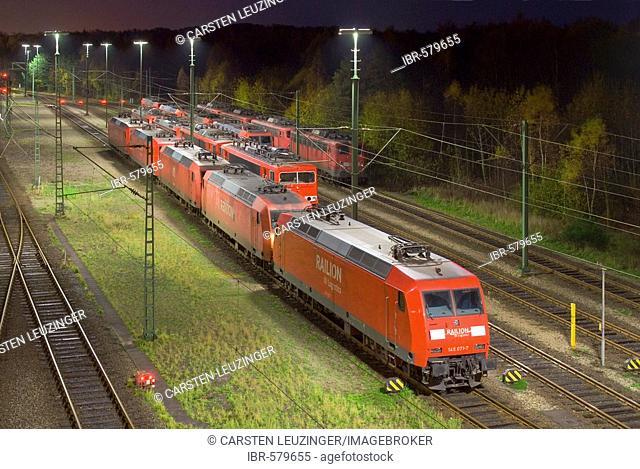 Parked electric locomotives at Maschen railroad shunting yard near Hamburg at night, Lower Saxony, Germany