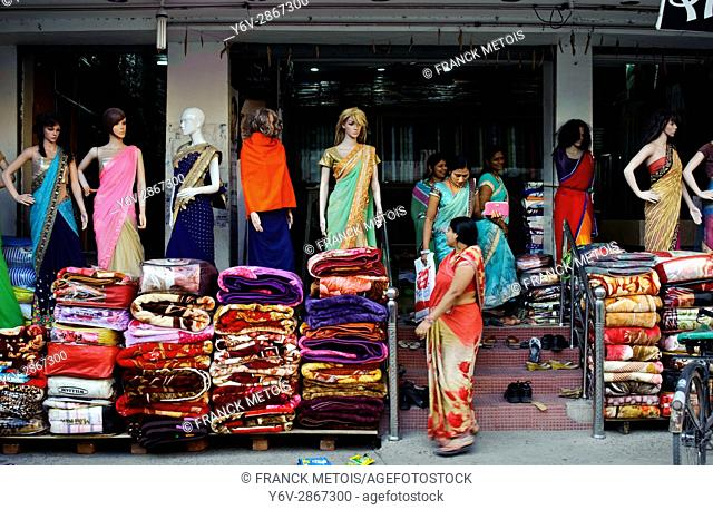 Shoppers are leaving a clothing shop ( Champa, Chhattisgarh state, India)