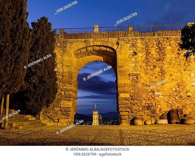 Arco de los gigantes at dusk, monumental city Antequera, Malaga province. Andalusia southern Spain