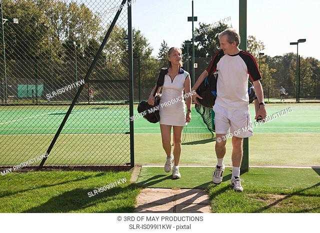 Couple walking to tennis courts