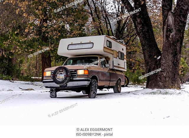 Campervan parked on snow covered ground, Yosemite National Park, California, USA