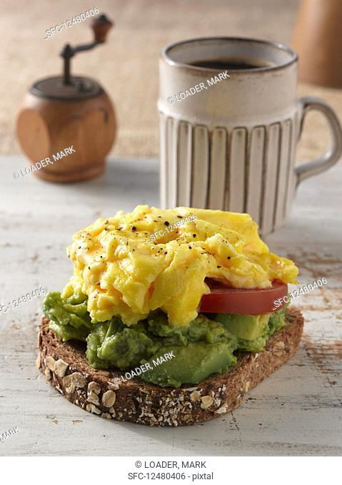 Bread with scrambled eggs and avocado