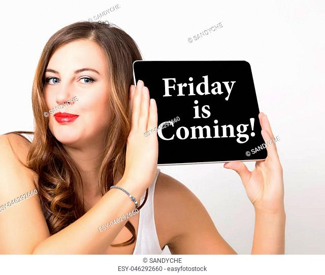 friday is coming written on virtual screen. technology, internet and networking concept. beautiful woman with bare shoulders holding pc tablet