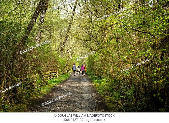 A family of hikers near on Fisherman's Trail by the Seymour River in North Vancouver, BC, Canada