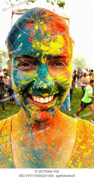 Portrait of woman covered with colorful paint