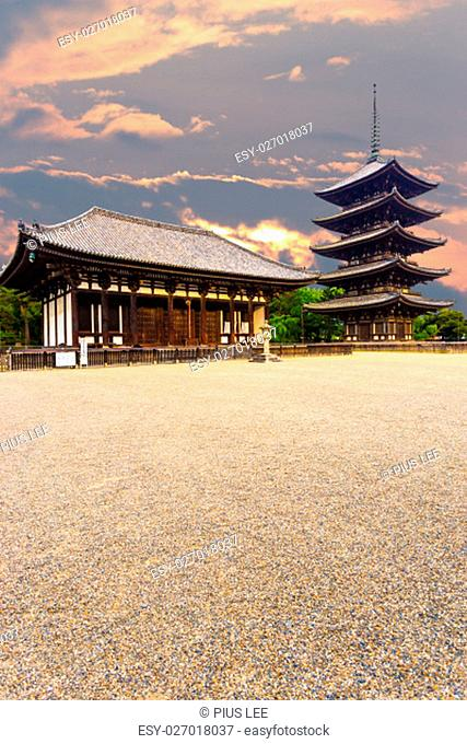 The front of the East Golden Hall, To-kondo, and five story pagoda, Goju-no-to, in Kofuku-ji Buddhist temple on beautiful sunset evening in Nara, Japan