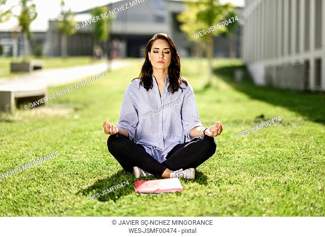 Portrait of student doing yoga exercices on campus