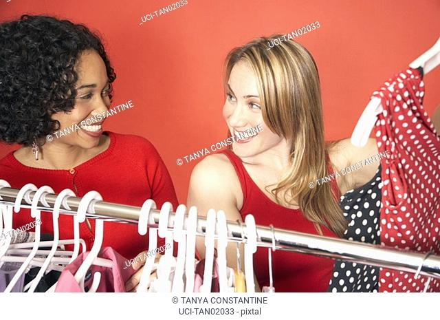 Women looking at clothes on rack