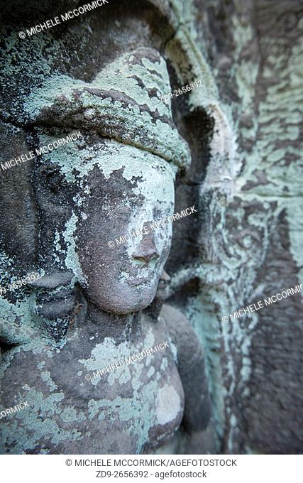 A carved stone figure at Ta Prohm survives the ages