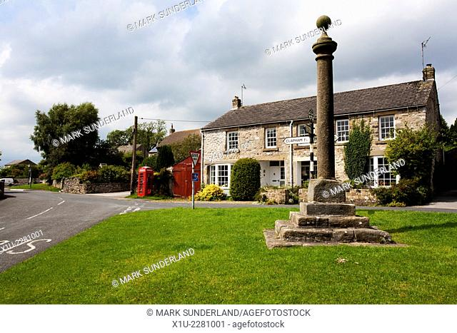 Market Cross in the Village of Austwick in Crummack Dale Yorkshire Dales England
