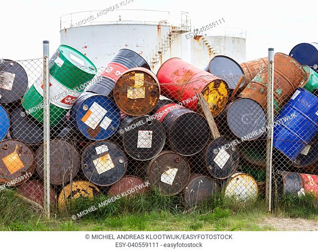 AKRANES, ICELAND - AUGUST 1, 2016: Oil barrels or chemical drums stacked up for cargo on August 1, 2016