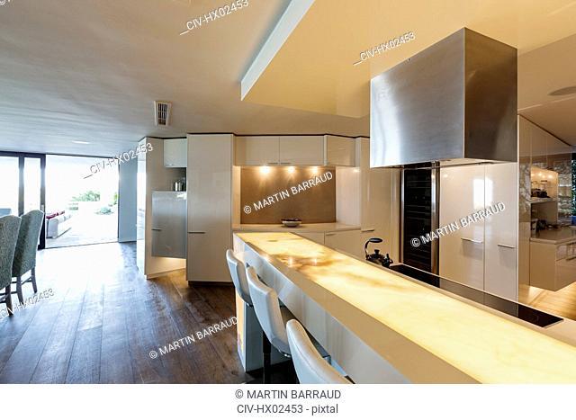 Illuminated, modern, minimalist luxury home showcase interior kitchen