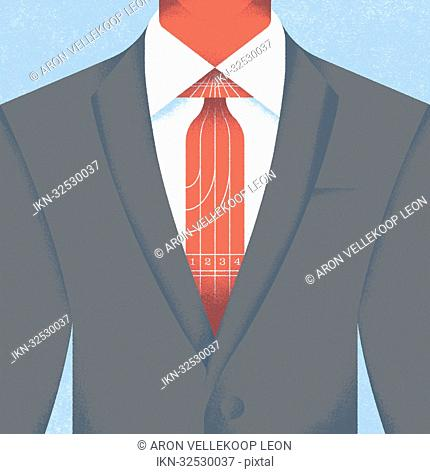 Close-up of businessman in suit wearing racetrack tie