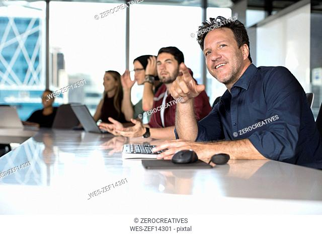 Business people sitting in conference room