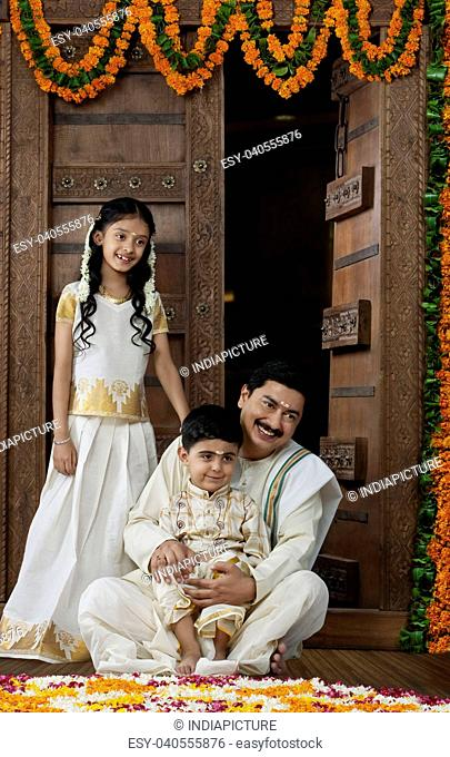 South Indian man with son and daughter