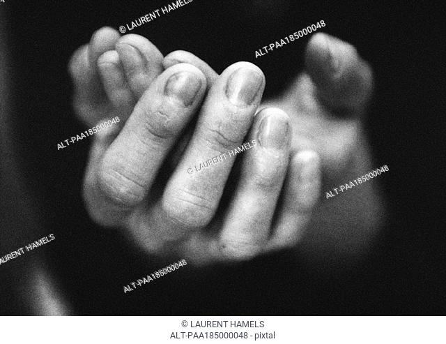 Hands cupped, close-up, b&w