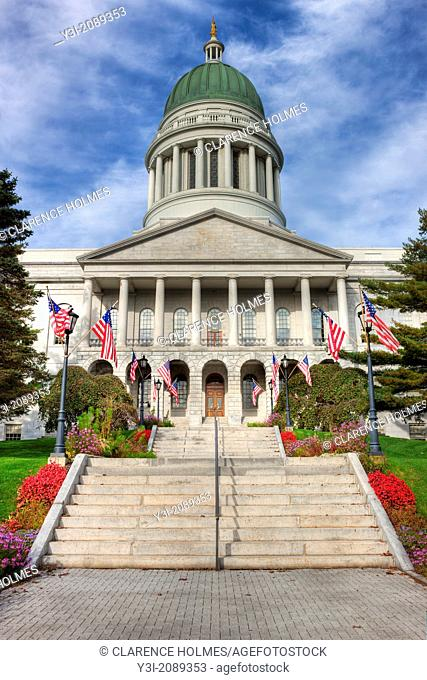 American flags flank the stairs to the front entrance of the Maine State House in Augusta, Maine