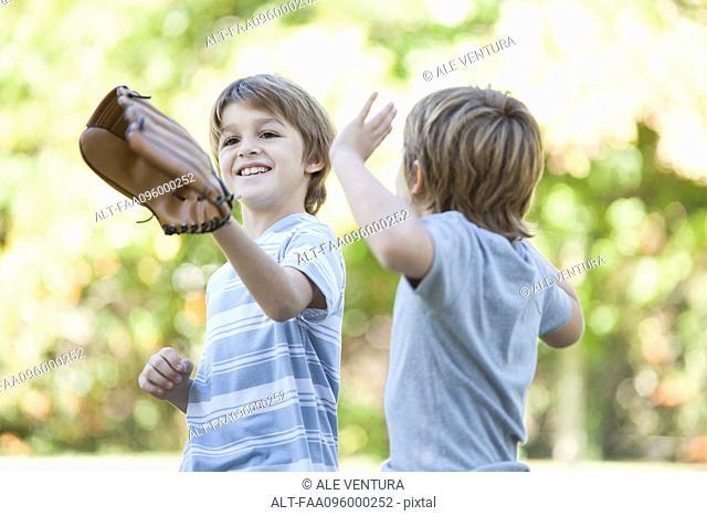 Boy wearing basebal glove