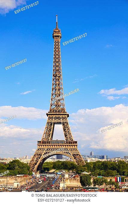 Eiffel Tower in Paris under blue sunny sky at France