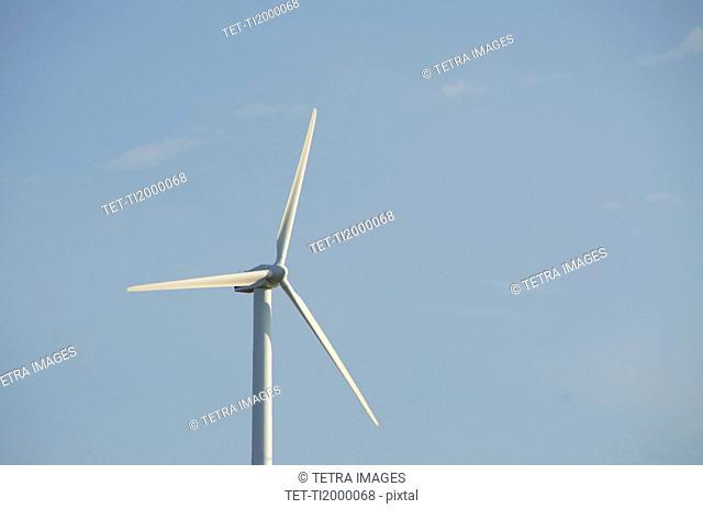 Turkey, Izmir, wind turbine against blue sky