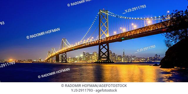 The Bay Bridge and San Francisco skyline at dusk