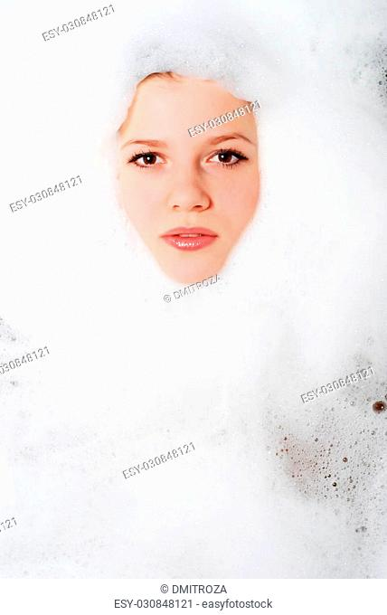 face of a beautiful woman in white foam