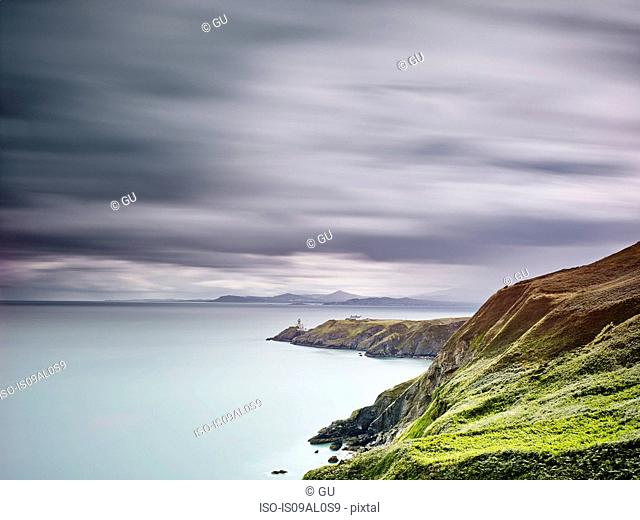 View of baily lighthouse on distant peninsula, Howth, Dublin Bay, Republic of Ireland