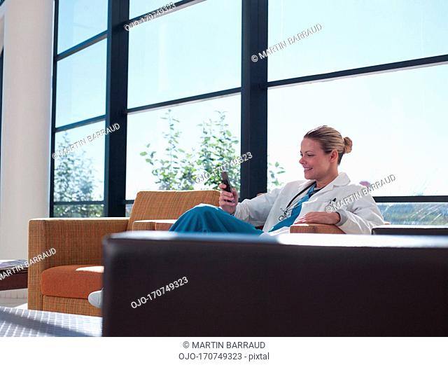 Doctor using cell phone in hospital