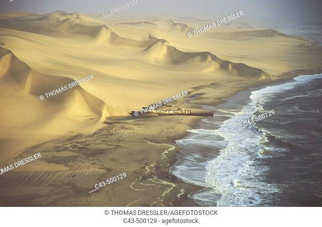 Aerial view of the Shaunee wreck, stranded in 1976 south of Walvis Bay, between Namib Desert and Atlantic Ocean. Namib-Naukluft Park, Namibia