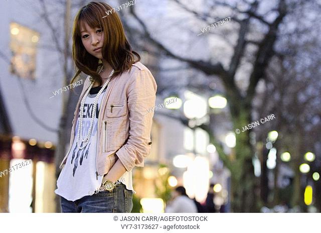 Japanese Girl poses on the street in Jiyugaoka, Japan. Jiyugaoka is a town located in Tokyo
