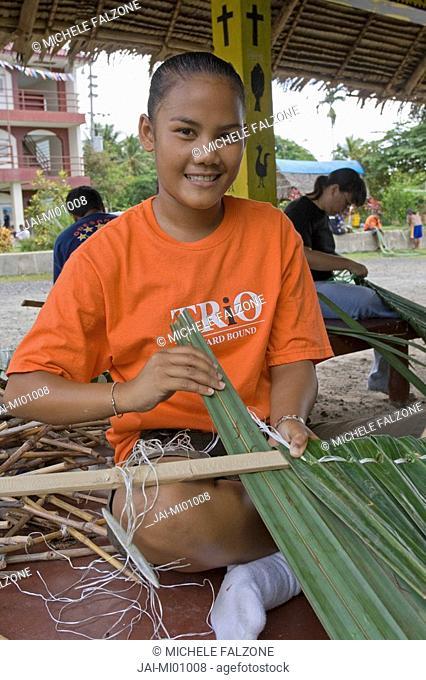 Young Palauan girl weaving a roof with Pandanus leaves, Koror High School, Palau, Micronesia