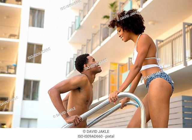 Young couple at poolside