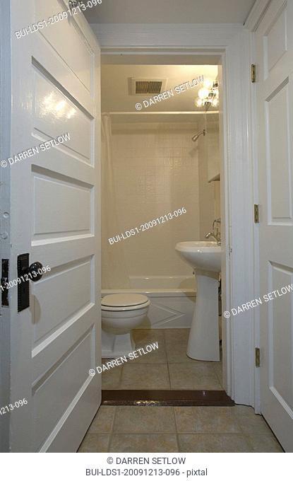 Doorway into bathroom with pedestal sink