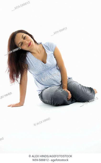 Young woman relaxing in the early stages of pregnancy