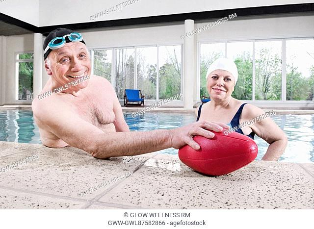 Portrait of a couple smiling in a swimming pool