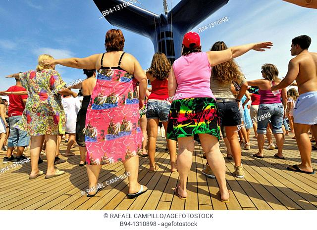 Passengers dancing on the deck of a cruise ship