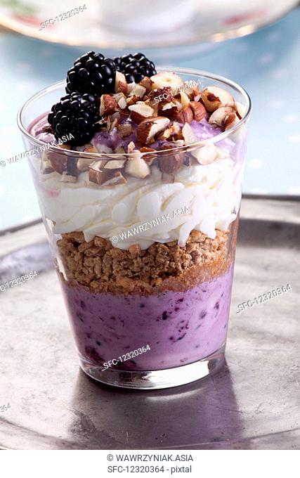 Creamy and blackberry dessert with hazelnuts