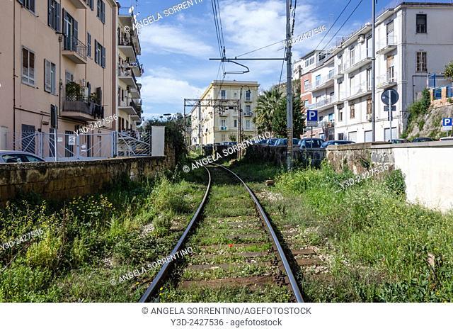 One-track way between buildings in Naples, Italy
