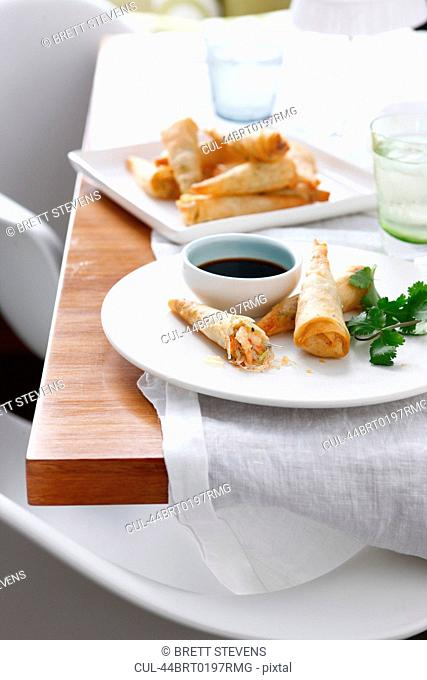 Plate of spring rolls and dipping sauce
