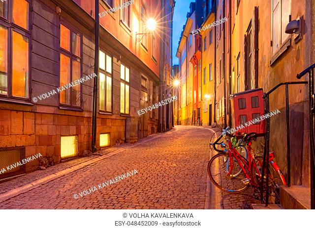 Empty street on the rainy night, Gamla Stan in Old Town of Stockholm, the capital of Sweden