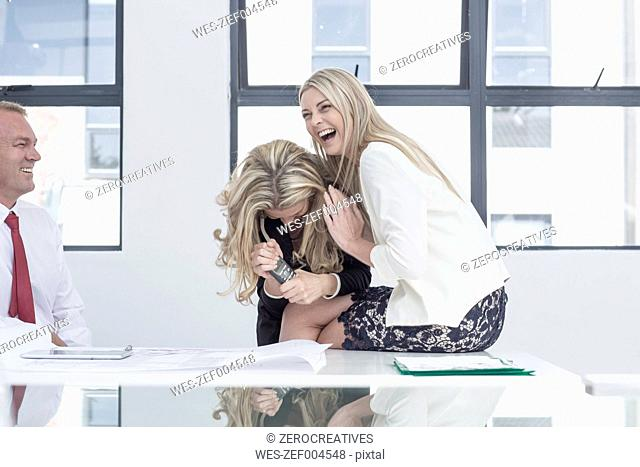 Businesswoman in office laughing happily